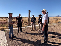 Law enforcement standing, talking during a training exercise.